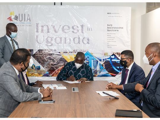 Ugandan Minsiter of Finance, Planning-and Economic Development Matia Kasaija signs the investment deals at the ceremony