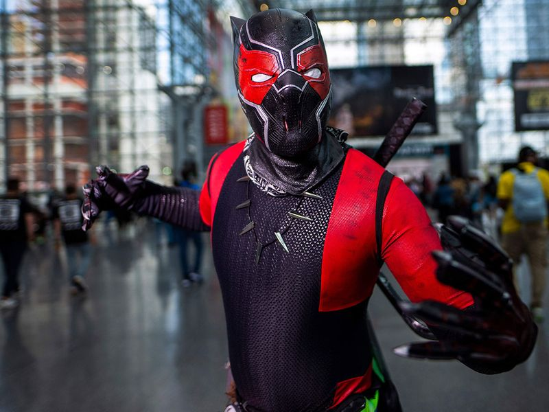 A costumed attendee poses during New York Comic Co
