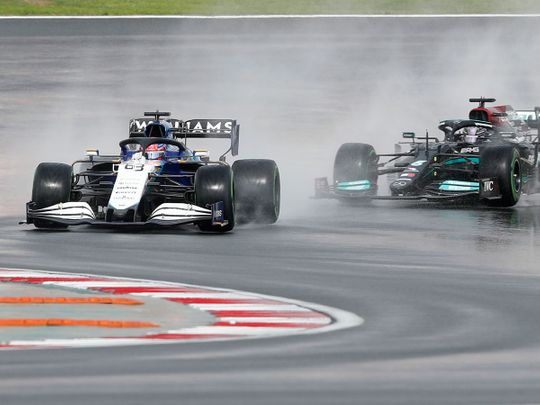 George Russell and Lewis Hamilton at a wet Turkish Grand Prix practice in Istanbul