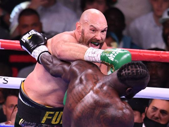 WBC heavyweight champion Tyson Fury of Great Britain lands a punch on US challenger Deontay Wilder