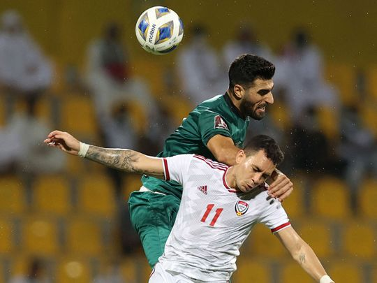 The UAE's Caio Jr battles with Iraq's defender Ahmed Khalaf during the 2022 Qatar World Cup Asian Qualifiers at the Zabeel Stadium in Dubai