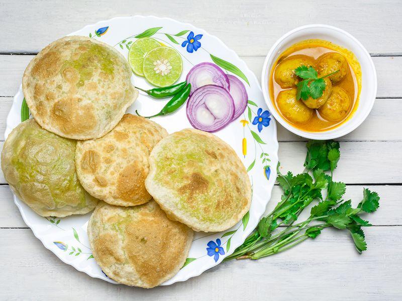 A traditional Bengali green peas puri or deep-fried savoury bread