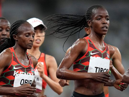 Agnes Tirop, right, competea in the women's 5,000-meters final at the 2020 Summer Olympics in Tokyo