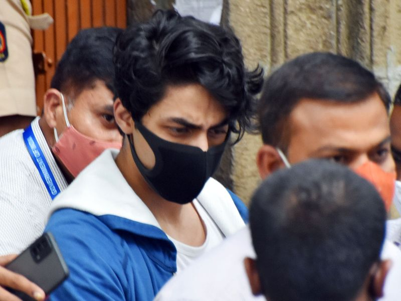 Bollywood actor Shah Rukh Khan's son Aryan Khan leaves the Narcotics Control Bureau (NCB) office to be produced before the court in a drug-related case, in Mumbai .