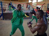 Coach Aziz Ousseini Doka training one of his students in the municipal stadium of Niamey, Niger