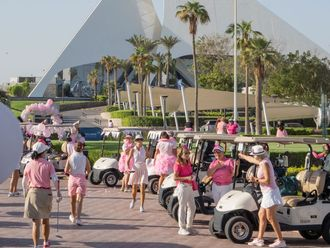 The teams assemble ahead of the Pink Day event at Dubai Creek Golf & Yacht Club