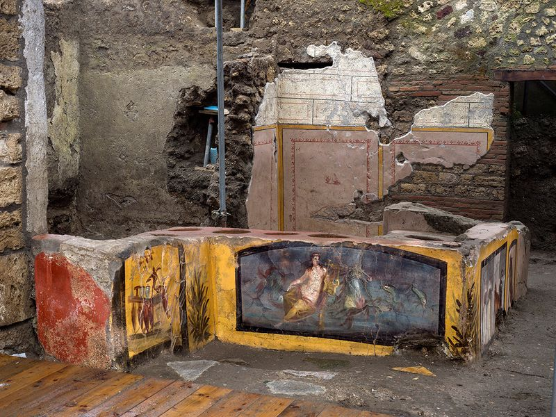A fresco on an ancient counter depicting a nymph riding a horse uncovered during excavations in Pompeii.