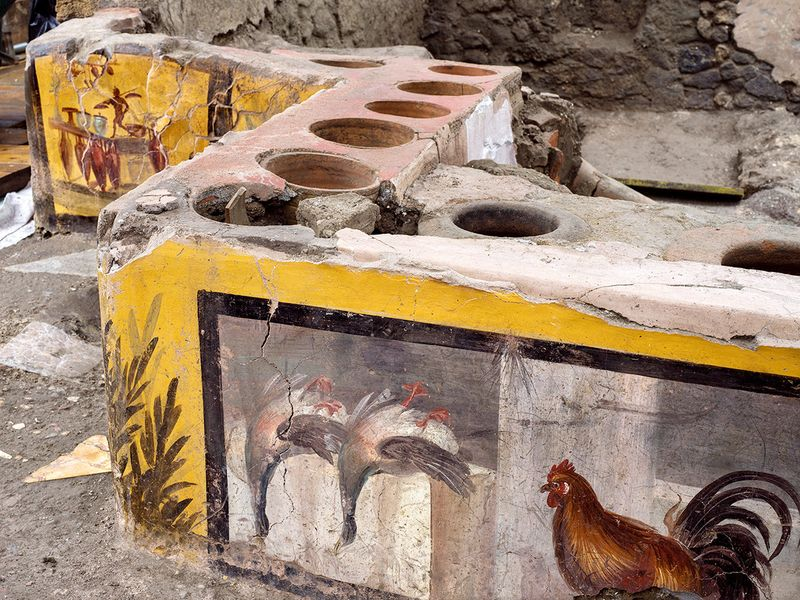 Frescoes on an ancient counter discovered during excavations in Pompeii.