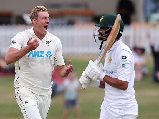New Zealand's paceman Kyle Jamieson celebrates the wicket of Pakistan's Shan Masood