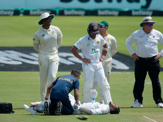 Sri Lanka's Dhananjaya de Silva receives medical attention during the first day of the first Test cricket match between South Africa and Sri Lanka at SuperSport Park in Centurion