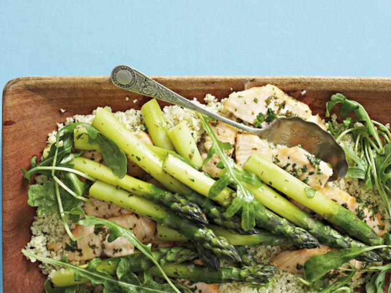 Pan-fried fish on quinoa salad with asparagus