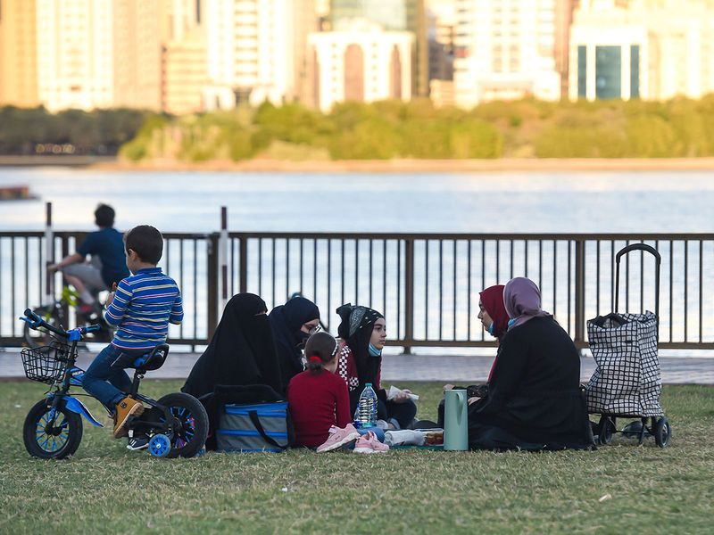 Families enjoying their winter holidays in the outdoor at Buheirah Corniche in Sharjah