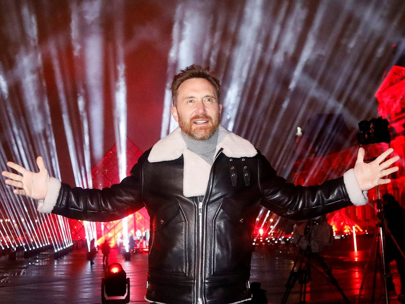 French DJ David Guetta poses in front of the Louvre Pyramid before performing the 'United at Home' fundraising live concert for New Year's Eve, in Paris, France, December 29, 2020. Picture taken December 29, 2020. REUTERS/Charles Platiau